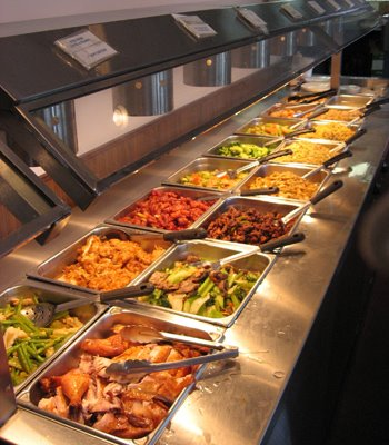 A buffet (UK: / ˈ b ʊ f eɪ /, US: / b ə ˈ f eɪ /, from French: sideboard) is a system of serving meals in which food is placed in a public area where the diners serve themselves. Buffets are offered at various places including hotels, restaurants and many social events.